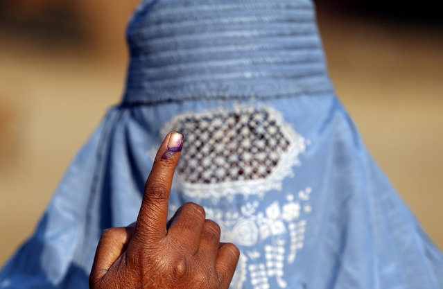 A woman shows her ink marked finger after voting during the state assembly election, in the village of Kairana, in the state of Uttar Pradesh, India, February 11, 2017. (Photo by Cathal McNaughton/Reuters)