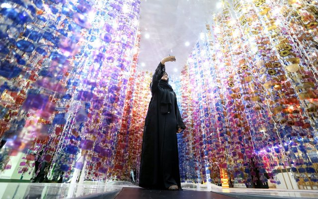 A UAE woman takes selfie photo at reflection light spot at Arabian Travel Market (ATM) fair in Dubai, United Arab Emirates, 29 April 2019. Over 2,500 exhibitors and 40,000 industry professionals from 150 countries are gathering at ATM 2019 which has adopted cutting-edge technology and innovation as its main theme. (Photo by Ali Haider/EPA/EFE/Rex Features/Shutterstock)