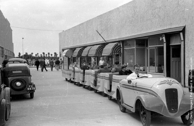 1939: Holidaymakers riding the train at Butlin's Holiday Camp, Skegness, Lincolnshire