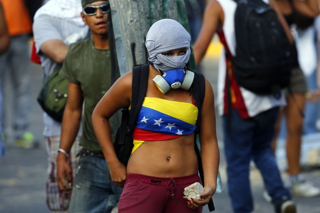 Anti-government protesters clash with the police at Altamira square in Caracas, on March 4, 2014. (Photo by Jorge Silva/Reuters)