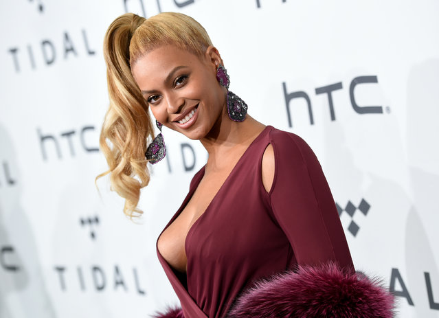 In this October 20, 2015 file photo, singer Beyonce Knowles arrives at TIDAL X: 1020 Amplified by HTC in New York. Beyonce is launching an active wear line for women next month. The singer announced the 2016 spring/summer collection called Ivy Park on Thursday. It's a collaboration with Sir Philip Green and will be available April 14. (Photo by Evan Agostini/Invision/AP Photo)