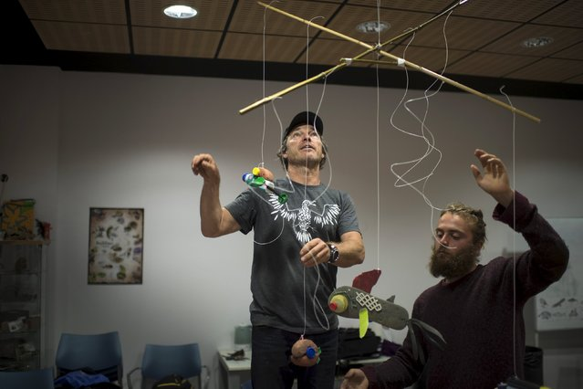 Xandi Kreuzeder (L) and Claudio Indao, surfers and members of the Skeleton Sea art collective, arrange a mobile during a workshop on how to make sculptures from plastic waste collected from the sea at the Torre Madariaga Biodiversity Centre in Busturia, Spain, May 17, 2015. (Photo by Vincent West/Reuters)