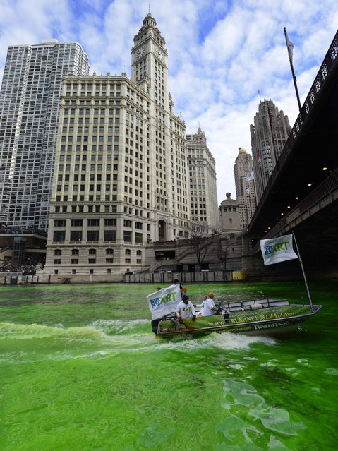 The Chicago River being dyed green ahead of the St. Patrick's Day parade in Chicago. (Photo by Paul Beaty/AP Photo)