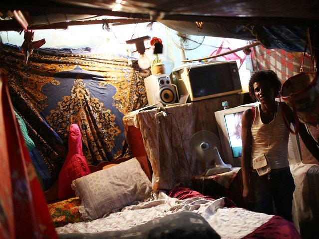 Resident Simone in her room in favela. (Photo by Mario Tama/Getty Images)