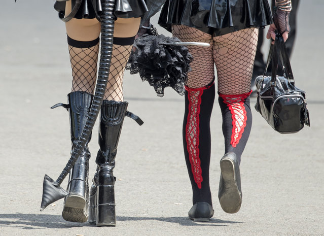 "Participants of the the goth festival ""Wave Gothic Festival"" walk in fancy costumes along the festival area  in Leipzig, central Germany, Saturday, May 23, 2015. About 20,000 members of the scene are expected to attend  one of the world's largest gothic and ""dark"" culture festivals until May 25,  2015. (Photo by Jens Meyer/AP Photo)"