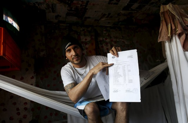 Inmate Ubaldo Marcus, 36, shows his secondary school certificates inside his cell at the transgender gallery in La Joya prison on the outskirts of Panama City, Panama January 29, 2016. Marcus was sentenced for drug trafficing. He moved to the transgender gallery after a dispute about money in his previous gallery. (Photo by Carlos Jasso/Reuters)