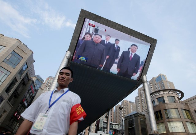 A television screen shows Chinese state media CCTV's footage of North Korean leader Kim Jong Un's meeting with Chinese President Xi Jinping in Pyongyang, in Beijing, China on June 20, 2019. (Photo by Jason Lee/Reuters)