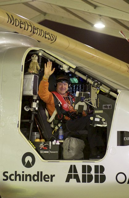 Swiss pilot Andre Boschberg waves in the cockpit of Solar Impulse 2 plane as he gets ready to take off at the Nanjing Lukou International Airport, Jiangsu province, China, May 31, 2015. The plane took off from eastern China's Nanjing after more than a month of delay to complete the most challenging leg yet of its Round The World adventure: the crossing of the Pacific via Hawaii. Pilots Piccard and Borschberg will take turns at the controls of Solar Impulse 2, which began its journey in Abu Dhabi in the United Arab Emirates on March 9, as it makes its way in the first round-the-world solar-powered flight in about 25 flight days at speeds of between 50 kph and 100 kph (30 mph to 60 mph). REUTERS/Stringer