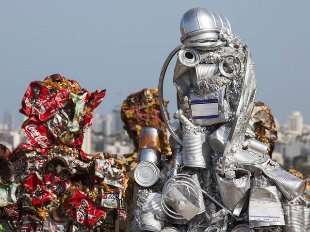 """Sculptures made of waste material titled """"Trash People"""" by German Artist Ha Schult in Ariel Sharon Park, in the suburbs of Tel Aviv. (Photo by Jack Guez/AFP Photo)"""