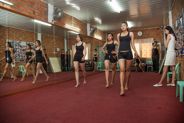 Sun Model School assistant Miss Voleak supervises the walk of aspiring female models during a training session at the school on March 31, 2014 in Phnom Penh, Cambodia. (Photo by Omar Havana/Getty Images)