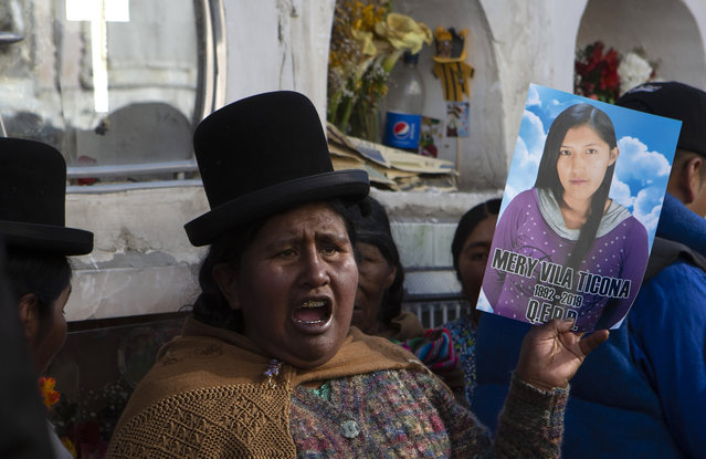 A relative chants for justice during the burial service of Mery Vila, who was killed by her partner, striking her several times on the head with a hammer, in La Paz, Bolivia, Thursday, July 11, 2019. Vila is one of 69 femicides reported in Bolivia since January, the highest in six years in the same period. The alarmingly high number in a country with South America's highest femicide rate has prompted the Women Affairs Commission to call an emergency meeting to allocate more resources for the fight against gender-based violence. (Photo by Juan Karita/AP Photo)