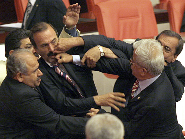 Turkey's main opposition Republican People's Party (CHP) MP Idris Sami Tandogdu (R) and an unidentified CHP MP (rear R) hit Turkey's ruling Ak Party MP Alim Tunc (2nd L) as others try to stop the fight during a debate in the Turkish parliament in Ankara May 28, 2007. (Photo by Nuri Kaynar/Reuters)