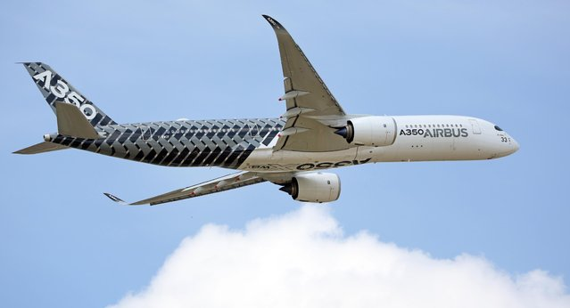 The new Airbus A350 performs its demonstration flight at the Paris Air Show in Le Bourget, north of Paris, Tuesday June 16, 2015. Some 300,000 aviation professionals and spectators are expected at this week's Paris Air Show, coming from around the world to make business deals and see dramatic displays of aeronautic prowess and the latest air and space technology. (AP Photo/Remy de la Mauviniere)