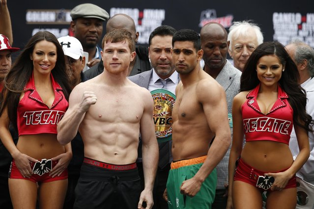 "Boxing, Saul ""Canelo"" Alvarez & Amir Khan Weigh-In, T-Mobile Arena, Las Vegas, United States of America on May 6, 2016: Amir Khan and Saul 'Canelo' Alvarez as promoter Oscar de la Hoya and Bernard Hopkins look on during the weigh in. (Photo by Andrew Couldridge/Reuters/Action Images/Livepic)"