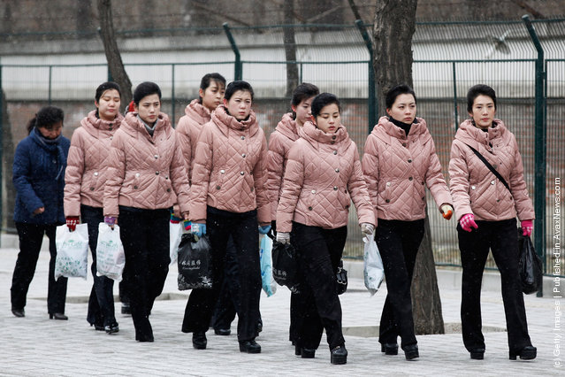 North Korean people arrive at the North Korea Embassy to mourn the death of North Korean leader Kim Jong-il