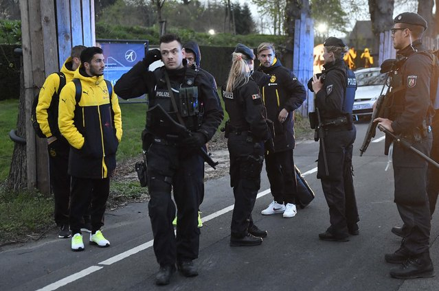 Dortmund's Marcel Schmelzer talks to police officers outside the team bus after it was damaged in an explosion before the Champions League quarterfinal soccer match between Borussia Dortmund and AS Monaco in Dortmund, western Germany, Tuesday, April 11, 2017.  (Photo by Martin Meissner/AP Photo)