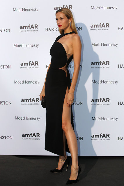 Model Petra Nemcova, of the Czech Republic, arrives for the AMFAR dinner, Sunday July 5 2015 in Paris, France. (Photo by Rafael Yaghobzadeh/AP Photo)