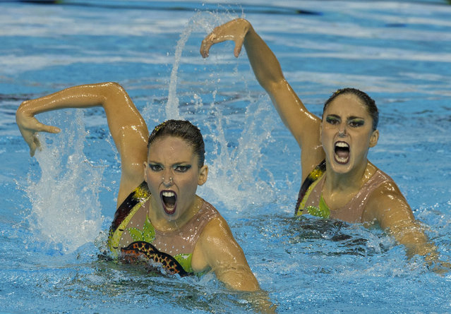 Brazil's Luisa Borges and Maria-Eduarda Miccuci perform their free routine in the synchronised swimming duet finals at the Pan Am Games in Toronto, Saturday, July 11, 2015. (Photo by Rebecca Blackwell/AP Photo)