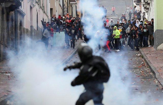 Demonstrators and security forces clash during a protest against Ecuador's President Lenin Moreno's austerity measures in Quito, Ecuador, October 8, 2019. (Photo by Ivan Alvarado/Reuters)