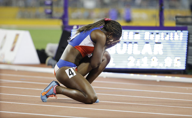 Cuba's Yorgelis Rodriguez reacts to the announcement that she has won the women's heptathlon following the heptathlon 800 meter run at the Pan Am Games in Toronto, Saturday, July 25, 2015. (Photo by Mark Humphrey/AP Photo)