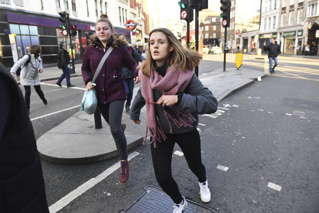 """People are evacuated from London Bridge in central London following a police incident, Friday, November 29, 2019. British police said Friday they were dealing with an incident on London Bridge, and witnesses have reported hearing gunshots. The Metropolitan Police force tweeted that officers were """"in the early stages of dealing with an incident at London Bridge"""". (Photo by Dominic Lipinski/PA Wire via AP Photo)"""