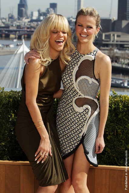 Rihanna and Brooklyn Decker pose as they attend the photocall for the movie 'Battleship' at the Corinthia Hotel
