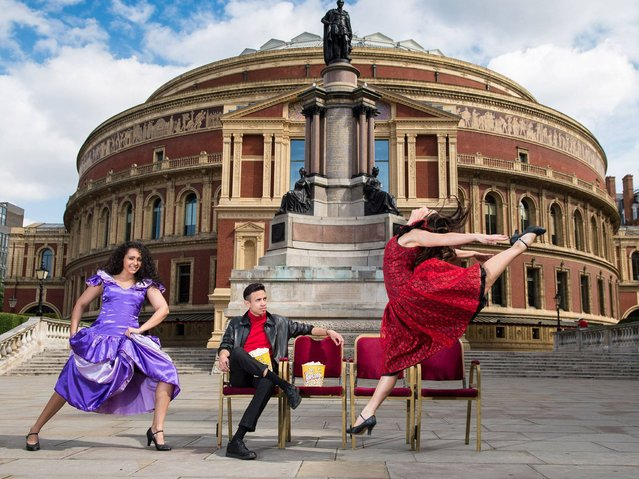 """Dancers leap in the air outside the Royal Albert Hall as the venue gears up for """"West Side Story-Film With Live Orchestra"""" on June 30, 2014 in London, England. West Side Story, the classic film accompanied by the Royal Philharmonic Concert Orchestra playing live on stage runs between Friday 4th July to Sunday 6th July with 25,000 Shark and Jet fans descending on the iconic venue. (Photo by Ian Gavan/Getty Images for Royal Albert Hall)"""