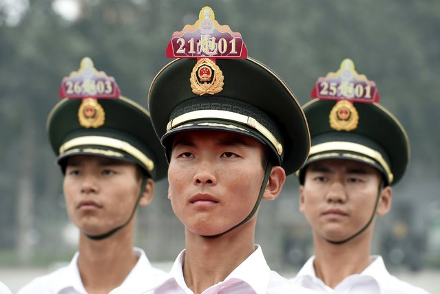 Identifying numbers are seen on hats as paramilitary policemen and members of a gun salute team stand in formation during a training session for a military parade to mark the 70th anniversary of the end of the World War Two, at a military base in Beijing, China, August 1, 2015. (Photo by Reuters/Stringer)