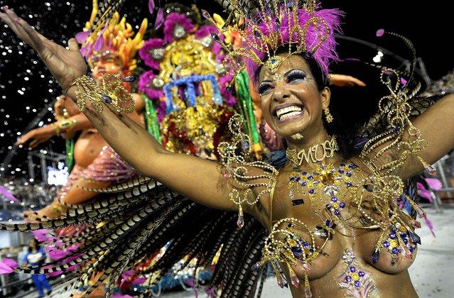 A reveller from the Aguia de Ouro samba school dances at the Sambadrome in Sao Paulo