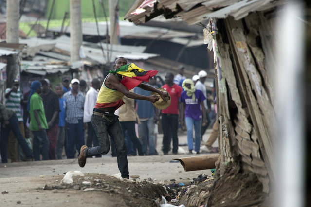 Supporters of Kenyan opposition leader and presidential candidate Raila Odinga engage Kenyan security forces in the Mathare area of Nairobi Wednesday, August 9, 2017. (Photo by Jerome Delay/AP Photo)