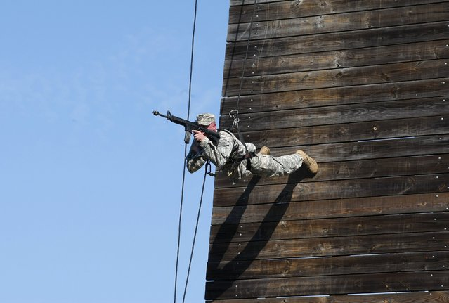 A U.S. Army Ranger shows skills during a demonstration at Ranger school graduation at Fort Benning in Columbus, Georgia August 21, 2015. (Photo by Tami Chappell/Reuters)