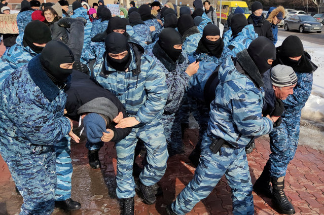 Kazakh law enforcement officers detain protesters during a rally held by opposition supporters, after anti-government activist has died of heart problems in a police detention center earlier this week, in Nur-Sultan, Kazakhstan March 1, 2020. (Photo by Tamara Vaal/Reuters)