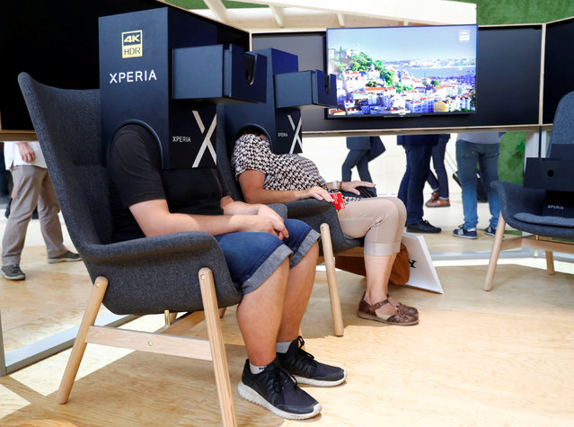 Visitors watch a Xperia 4K HDR presentation from Sony at the IFA Electronics Show in Berlin, Germany, September 1, 2017. (Photo by Fabrizio Bensch/Reuters)