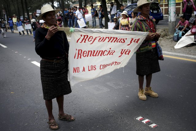 Indigenous people participate in a demonstration demanding the resignation of Guatemalan President Otto Perez Molina in Guatemala City, August 27, 2015. Former Guatemalan Vice President Roxana Baldetti will be held in jail throughout her trial over an alleged customs racket, a judge ruled on Wednesday. Baldetti, who was arrested on Friday, has been charged with illicit association, bribery and fraud over a customs racket she allegedly led with President Otto Perez. (Photo by Jorge Dan Lopez/Reuters)