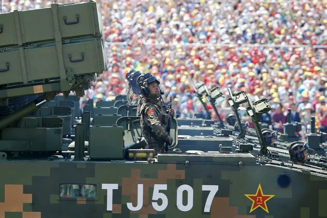 Soldiers of the People's Liberation Army (PLA) of China, on their armoured vehicles equipped with anti-tank missiles, arrive at Tiananmen Square during the military parade marking the 70th anniversary of the end of World War Two, in Beijing, China, September 3, 2015. (Photo by Damir Sagolj/Reuters)