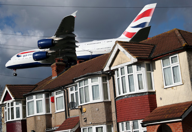 A British Airways Airbus A380 aircraft arrives over the top of residential houses to land at Heathrow Airport in west London, Britain, February 27, 2020. (Photo by Hannah McKay/Reuters)