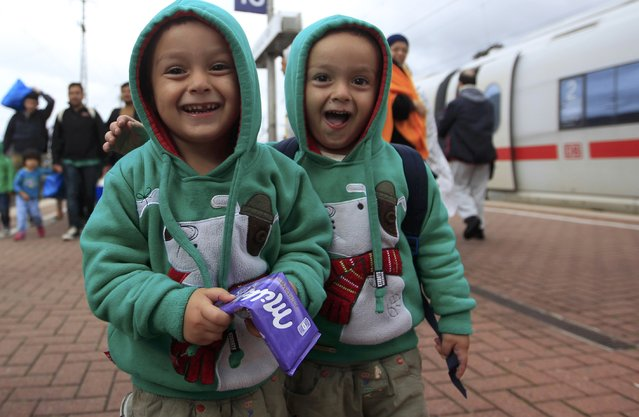 Young migrant boys smile as they arrive at the main railway station in Dortmund, Germany September 6, 2015. (Photo by Ina Fassbender/Reuters)