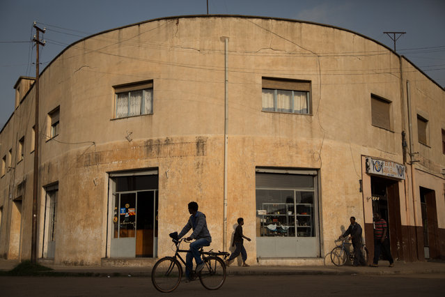 A man cycles through Amsara. Cycling is one of the country's most beloved pastimes – two Eritreans, Daniel Teklehaimanot and Merhawi Kudus, took part in the Tour de France in 2015. (Photo by Stéphanie Buret/The Guardian)