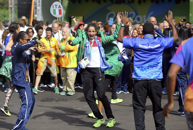 Members of the contigents from Italy (ITA) and the Solomon Islands (SOL) dance during the team welcoming ceremonies in Rio de Janeiro, Brazil on August 4, 2016. (Photo by Ivan Alvarado/Reuters)