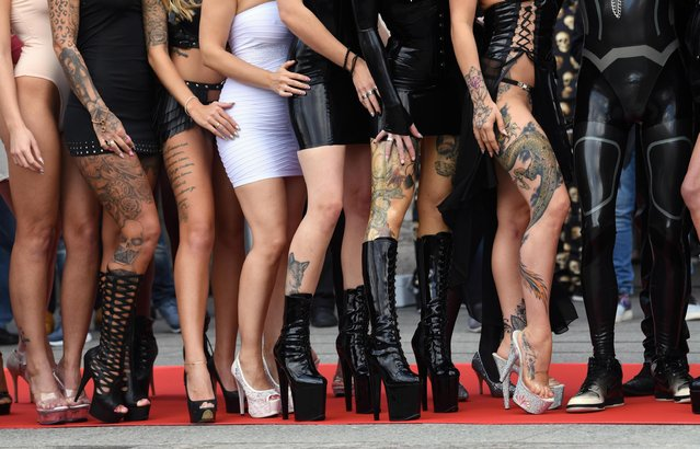 Women on high heels perform at the annual Venus erotic trade fair in Berlin, Germany on 12 October 2017. (Photo by Alamy Live News)