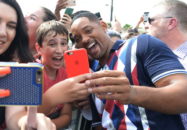 "Actor Will Smith takes a selfie with fans at the ""Suicide Squad"" Wynwood Block Party and Mural Reveal on July 25, 2016 in Miami, Florida. (Photo by Gustavo Caballero/Getty Images for Warner Bros. Pictures)"