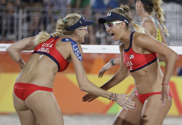 United States' Kerri Walsh Jennings, left, celebrates with her teammate April Ross, right, winning a point during a women's beach volleyball match against Australia at the 2016 Summer Olympics in Rio de Janeiro, Brazil, Sunday, August 7, 2016. (Photo by Petr David Josek/AP Photo)