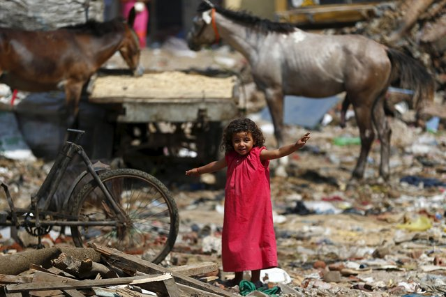 A girl plays in the Eshash el-Sudan slum in the Dokki neighbourhood of Giza, south of Cairo, Egypt September 2, 2015. (Photo by Amr Abdallah Dalsh/Reuters)