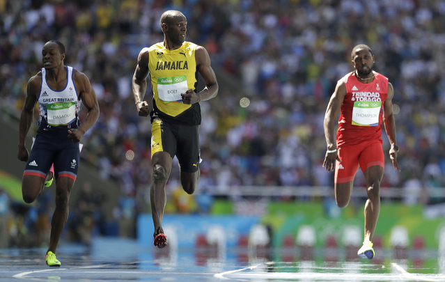 Jamaica's Usain Bolt, center, Trinidad and Tobago's Richard Thompson, right, and Britain's James Dasaolu compete in a men's 100-meter heat during the athletics competitions of the 2016 Summer Olympics at the Olympic stadium in Rio de Janeiro, Brazil, Saturday, August 13, 2016. (Photo by David J. Phillip/AP Photo)