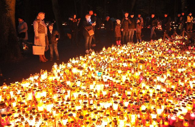 Candles burn on All Saints' Day at the Central Cemetery in Szczecin, Poland, November 1, 2017. People all over Poland visit the graves of beloved ones and leave candles and flowers on them.The cemetery in Szczecin is considered to be the largest necropolis in Poland. (Photo by Marcin Bielecki/EPA/EFE/Rex Features/Shutterstock)