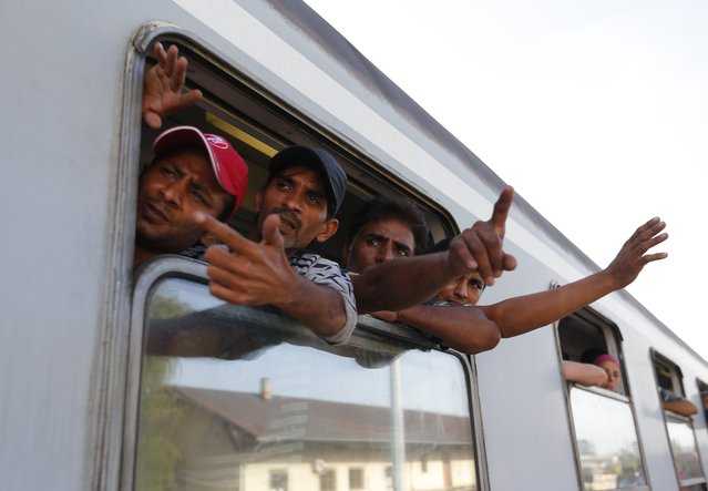 Migrants look out of a train window at the station in Beli Manastir, Croatia September 18, 2015. (Photo by Laszlo Balogh/Reuters)