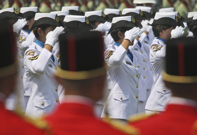In this August 17, 2012 photo, female members of Indonesian Navy salute during a ceremony commemorating the Independence Day at Merdeka Palace in Jakarta, Indonesia. Indonesia's military and police continue to perform abusive virginity tests on female recruits three years after the World Health Organization declared they had no scientific validity, an international human rights group said Wednesday, November 22, 2017. (Photo by Dita Alangkara/AP Photo)