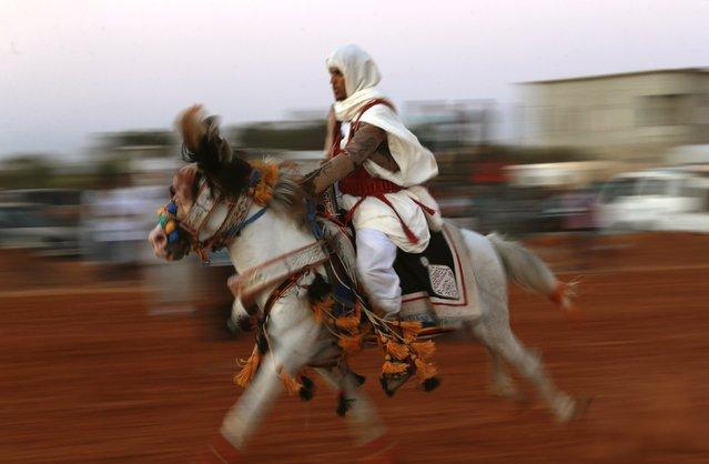 A horse rider dressed in a traditional costume participates in the annual Libyan equestrian festival, in Benghazi, October 10, 2014. (Photo by Esam Omran Al-Fetori/Reuters)