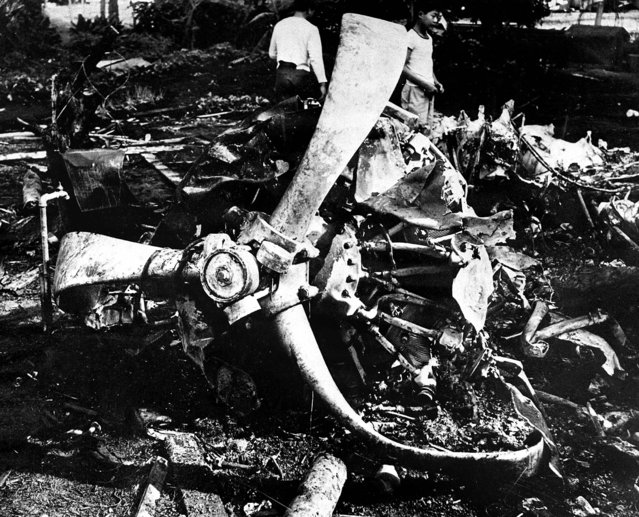 Youths inspect the wreckage of a Japanese bomber, December 17, 1941 brought down by a United States P-40 plane during the December 7 attack on Oahu, Hawaii.  (Photo by Associated Press)