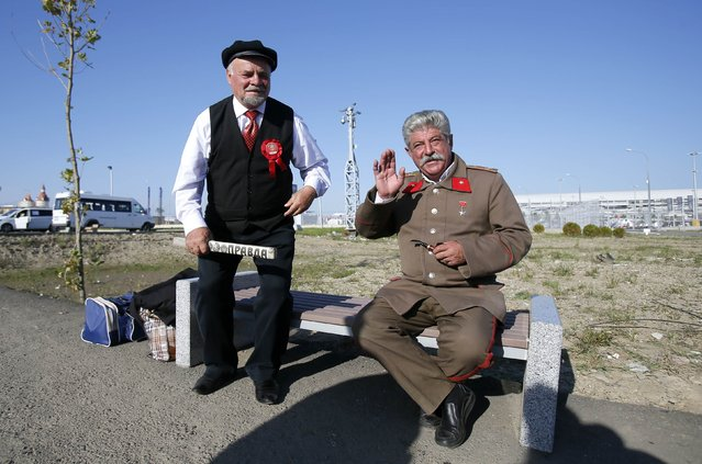 Men dressed as Soviet state founder Vladimir Lenin and Soviet leader Joseph Stalin pose for a picture in front of the paddock before the start of the Russian F1 Grand Prix in the Sochi Autodrom circuit October 12, 2014. (Photo by Maxim Shemetov/Reuters)